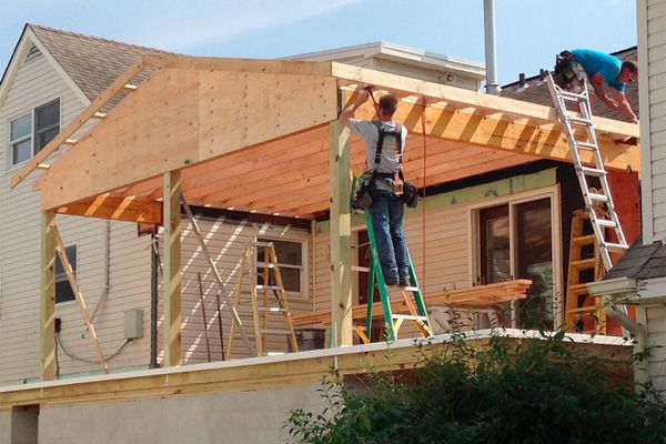A screened in deck under construction- good how to instructions and guidance