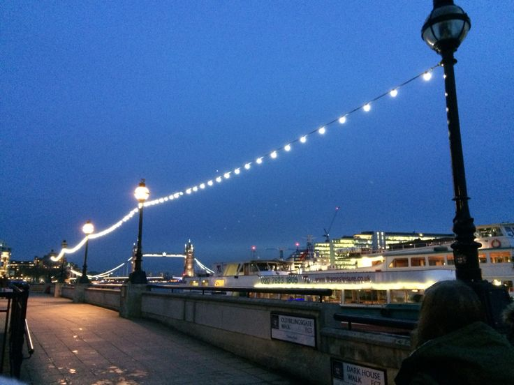 Cute pic of the lamp posts and fairy lights alongside the river Thames in London