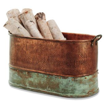 Great idea for firewood storage inside with copper bucket