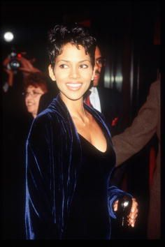 Actress Halle Berry stands at a charity benefit screening of her movie 'Race the Sun' March 16 1996 in New York City The movie is a fictionalized...