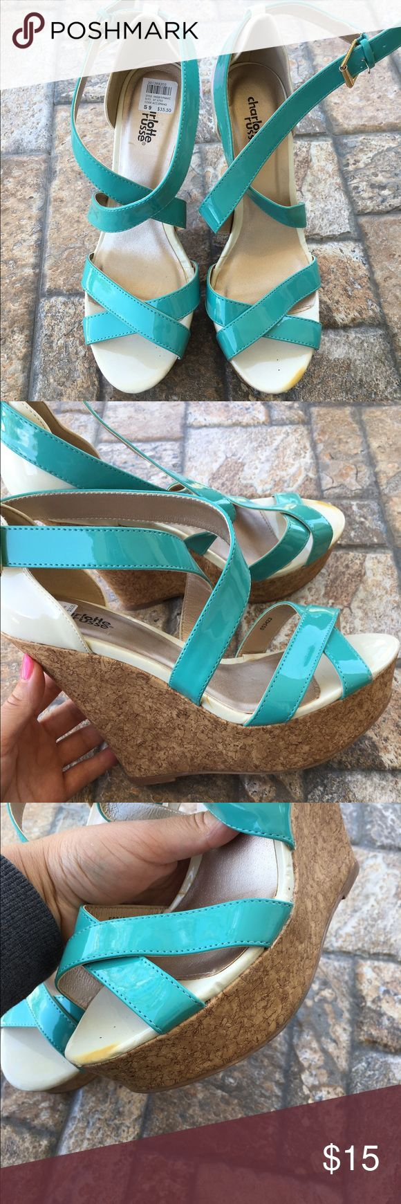 NEW Strappy turquoise wedges Teal blue cork board strappy wedges. Brand new as you can see from the soles. These are be perfect summer heels. Size 9.  ✮ Condition:  New but there is a yellow mark at the toe as shown in the photos.  ✮ Closet Rules:  ⇢ NO SWAPS  ⇢ NO HOLDS  ⇢ PLEASE ASK FOR MEASUREMENTS ⇢ I WILL MODEL ANYTHING THAT FITS IF REQUESTED  ⇢ I USUALLY SHIP SAME OR NEXT BUSINESS DAY  #wedges #summer #bright #poolpartyheels #teal #turqouise #fauxpatentleather #corkboard #summerheels…