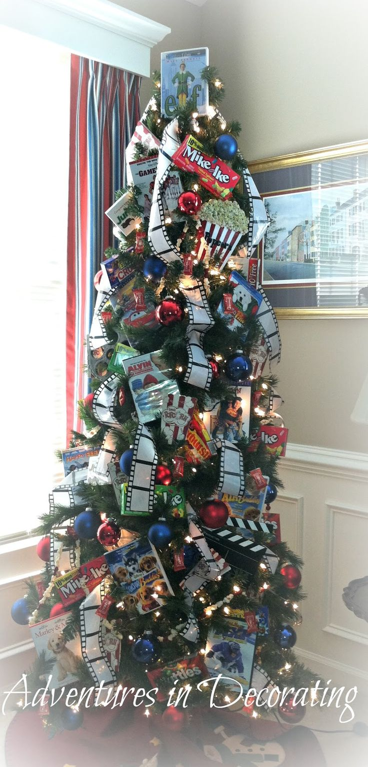 Movie themed tree--wouldn't want for main tree but cute for TV/game room. Put all holiday classics & movie snacks ready to grab on movie night.