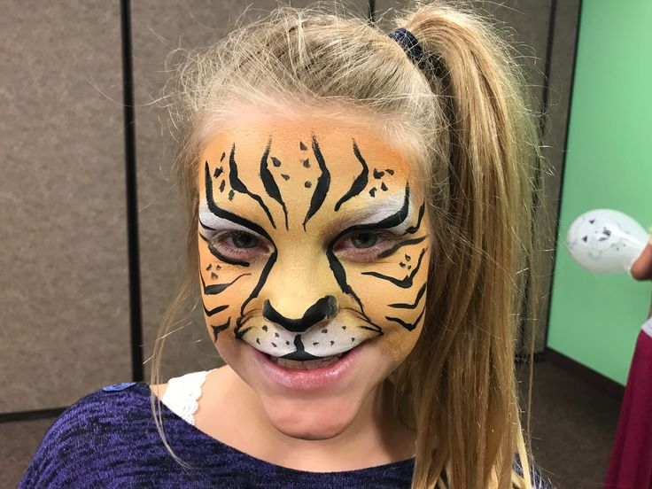 Orange tiger face paint painting