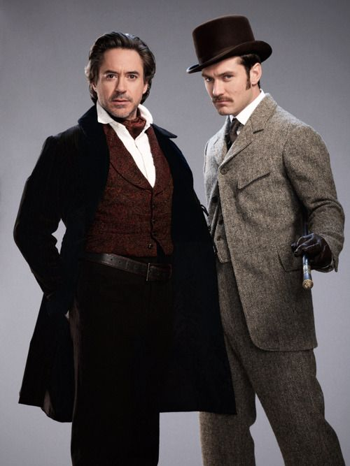 "Robert Downey Jr. and Jude Law in character as ""Sherlock Holmes"" and ""Dr. John Watson"" in a promotional image for Sherlock Holmes: A Game of Shadows"", 2011"