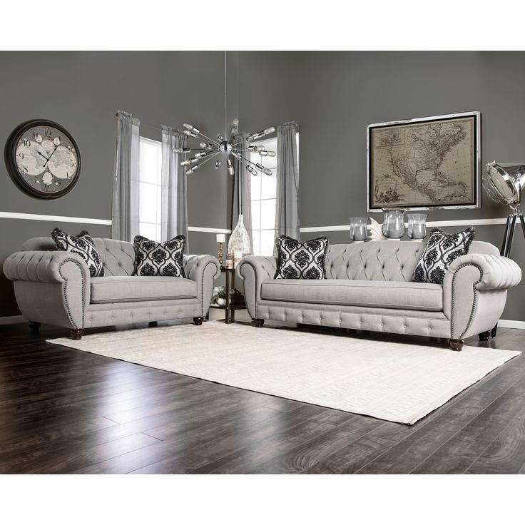 Inspired by victorian elegance, this 2-piece sofa set offers a modern twist to the traditional chesterfield structure while keeping in line with royal appearances. The warm grey fabric wraps tightly around dacron-wrapped foam.