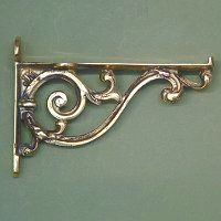 Solid brass decorative bathroom shelf brackets are made in the UK using traditional casting methods.  The solid brass will take on a lovely patina over time giving them a vintage look as the brass tarnishes very slowly.