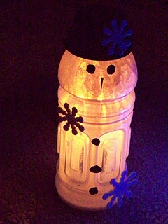 Recycled Bottle Snowman-need gatorade bottle, giant dr. pepper bottle, black take-out container, cut up newspaper for snow at bottom, pieces of lids cut up???, battery lit candle, black straws cut into glasses...