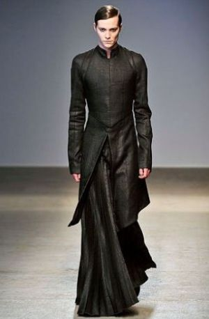 "While androgyny is IN this fall, this looks like Darth Vader on the Runway. Did he get to the end of the catwalk and say, ""Luke, I am your faaaather."""