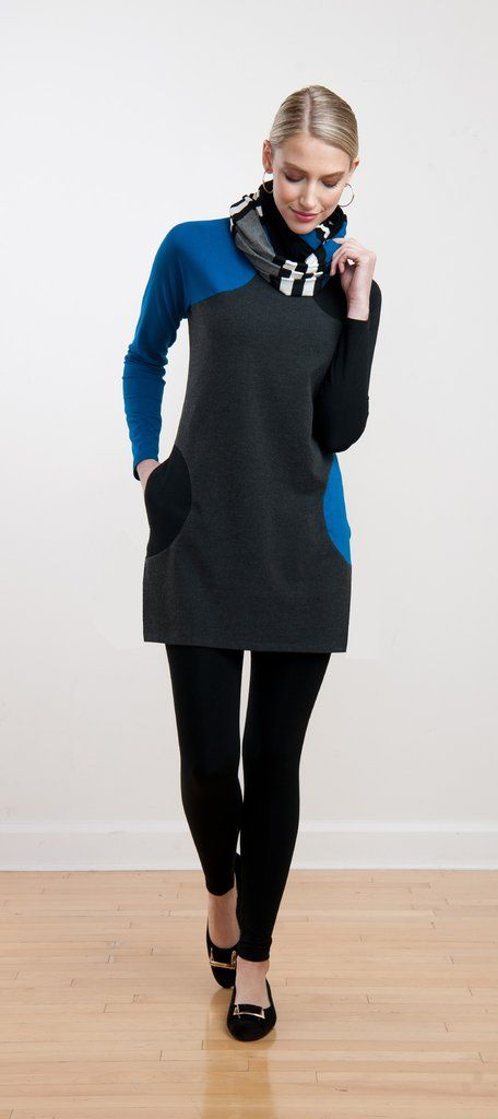 Unique tunic with modern geometric detailing has circular contrast-colour pockets and raglan sleeves