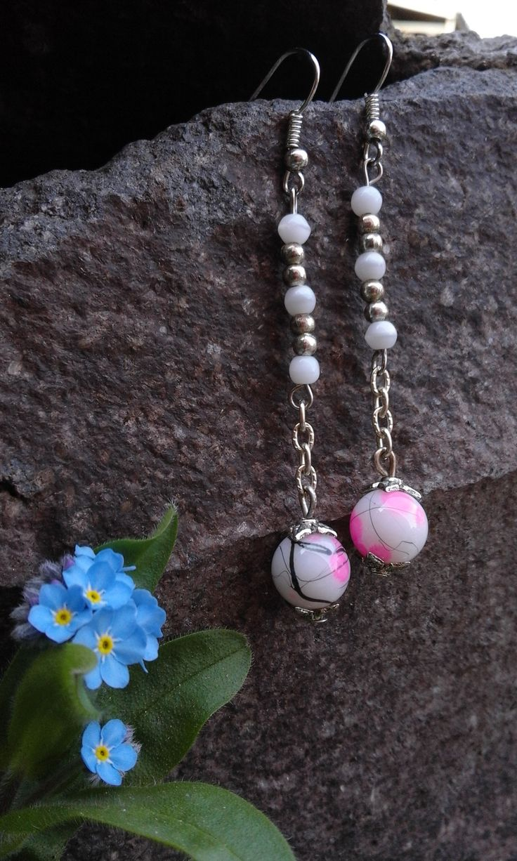 A pair of earrings of silver-white-pink beads and chain. I've made a necklace and bracelet that are fits to them.
