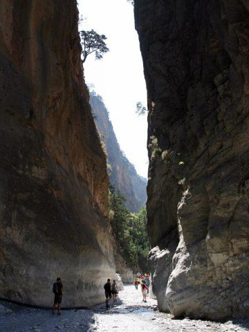 """VISIT GREECE  Samaria gorge, Crete. In the prefecture of Chania (also written """"Hania""""), the Samaria gorge is the longest in Europe (total length 16km), and one of the most impressive gorges in Greece. It starts from Xylóskalo, at an altitude of 1,230m. The width of the gorge is 150m at its widest point and 3m at its narrowest."""