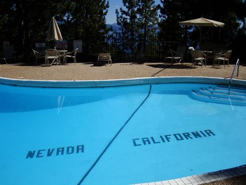 At the Cal-Neva Lodge in Lake Tahoe, the Nevada/California state lineactually runs through the swimming pool.  This is cool a cause you can tell people you swam from Nevada to California.