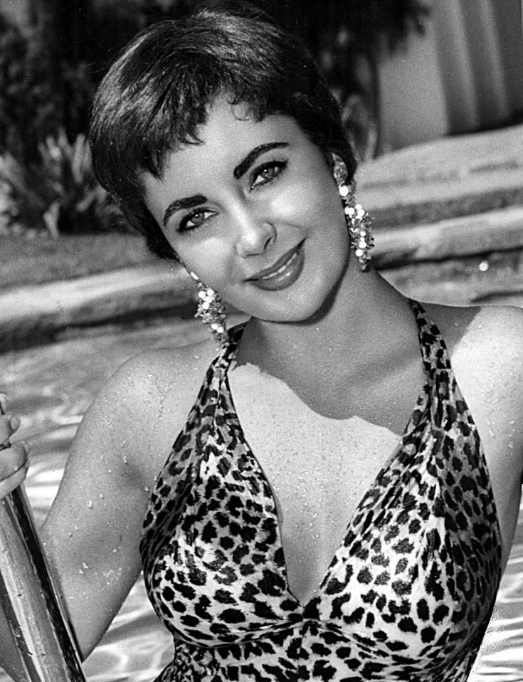 Elizabeth Taylor with short hair in a leopard print swimsuit. This photo is a publicity photo from film The Last Time I Saw Paris in 1954.