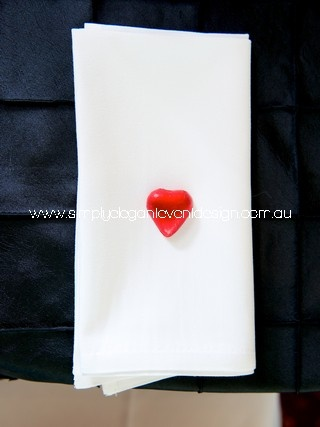 One of the cheapest bombonieres is simply to place a chocolate heart on the napkin