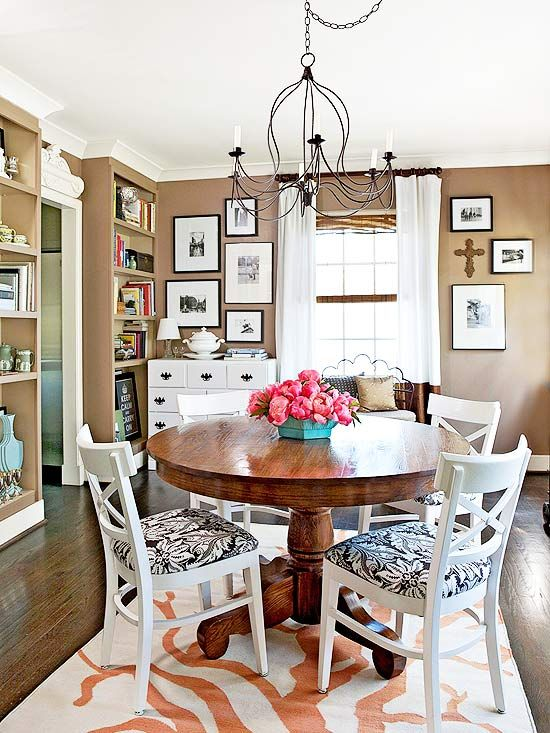 love the medley of a dark wood table + white chairs, great pattern here too