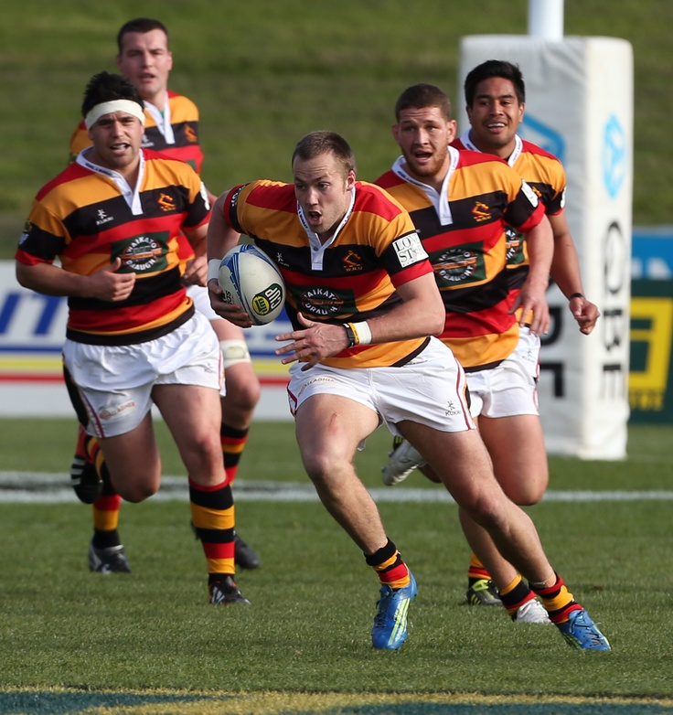 Tim Mikkelson making a break for it against North Harbour. www.mooloo.co.nz