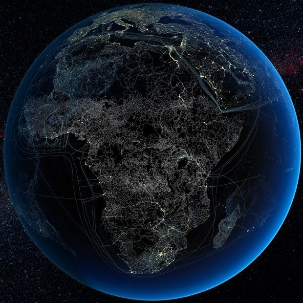 Human technology presence over Africa at night. Global map showing major road and rail networks over land, along with transmission line and underwater cable data superimposed over satellite images of cities illuminated at night.