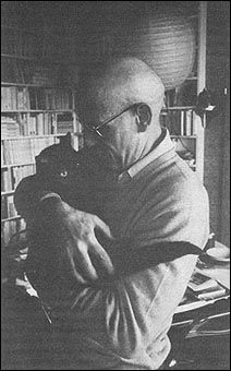 Michel Foucault and his beautiful black kitty. I love it when they hold them like babies. Obviously the loves of their lives.