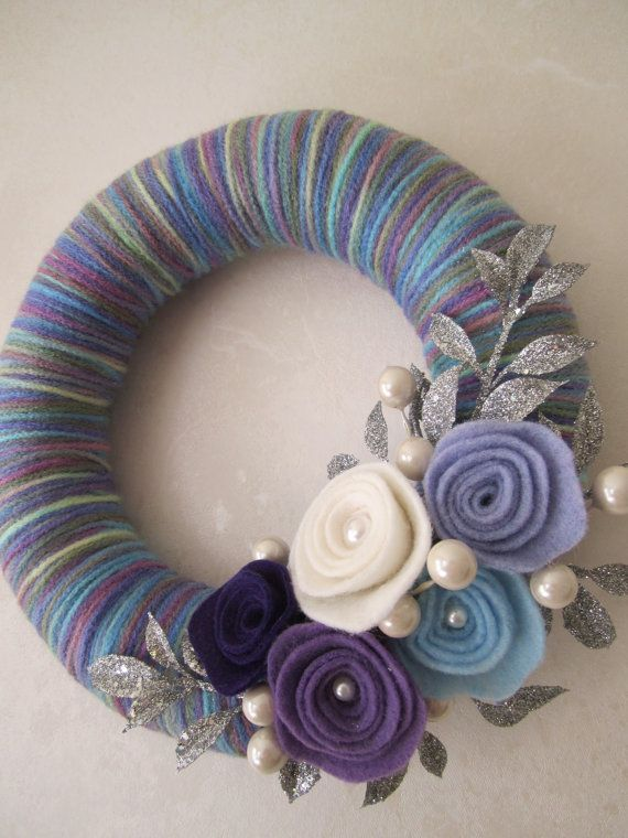8 inch straw wreath wrapped in purple/ blue mixed color yarn, decorated with felt roses, pearls, and glitter silver leaves. No instructions, just ideas!