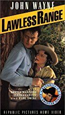 John Wayne and Sheila Bromley in Lawless Range (1935)