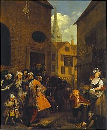 Noon. The scene takes place in Hog Lane, part of the slum district of St Giles with the church of St Giles in the Fields in the background. Hogarth would feature St Giles again as the background of Gin Lane and First Stage of Cruelty. The picture shows Huguenots leaving the French Church in what is now Soho.