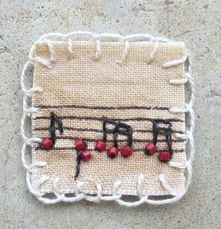 "embroidered - musical notes - a little ""inchie""!  How sweet love the beads"