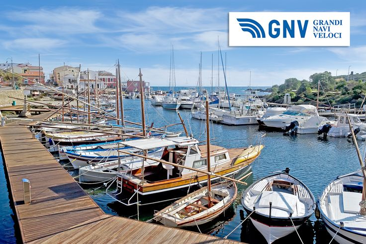 A #dock with boats and wooden boardwalk, #Sardinia. Discover #GNV routes from/to #PortoTorres here: www.gnv.it/en
