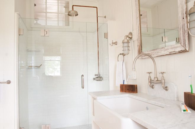 Wood toothbrush holders. Also love the white, on white, on white throughout this whole house. And the exposed copper piping for the bathroom plumbing. (Shower, sink, toilet.)  Beach style bathroom by allee architecture + design, llc