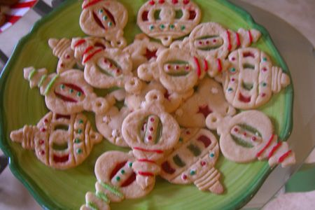 Ornament shaped stained glass cookies.  Lifesavers are used for the stained glass effect.