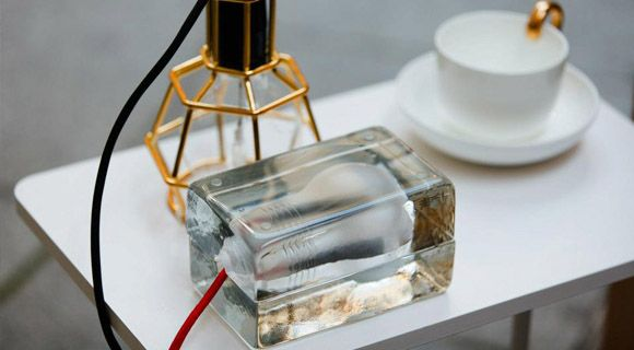 Work Lamp in gold by Form Us With Love, Block lamp by Harri Koskinen, Mine teacup by Anna Kraitz. Design House Stockholm.