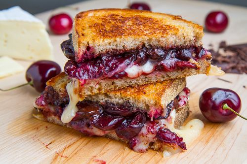 1/2 cup cherries, pitted and halved 1 teaspoon balsamic vinegar (or brandy or port) 1 tablespoon butter 2 slices bread 1 1/2 ounces brie, room temperature 1 ounce dark chocolate, chopped, room temperature
