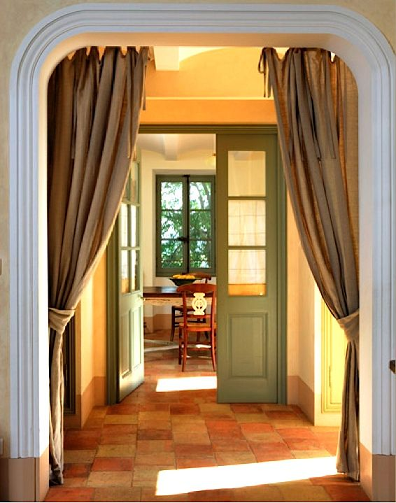 I have wanted to do Portiere's in my living room entrance for ever. velvet for winter and linen for summer, Love the use of curtians in doorway instead of a door