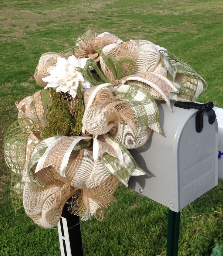 Burlap mailbox cover with burlap flowers, ribbons and to complete the design, a moss butterfly. Check out my FB page: Ms. Kay's a-DOORable Designs