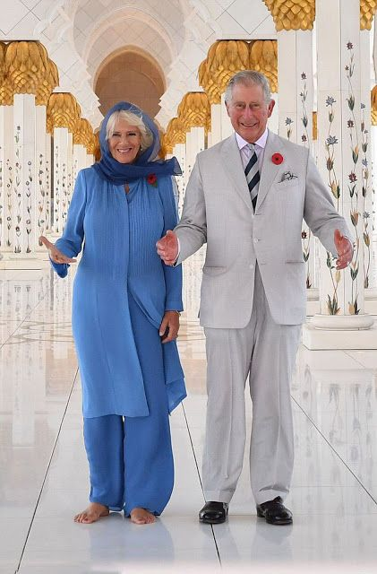 Prince Charles was dressed in a linen suit and striped tie, while Camilla, Duchess of Cornwall wore a blue headscarf, long jacket and trousers