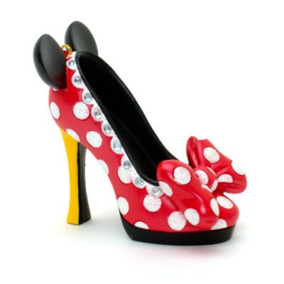 This dazzling Minnie Mouse Miniature Decorative Shoe will make a perfect gift. Our ornamental shoe collection captures the magical spirit of Disney in each of its character-based designs.
