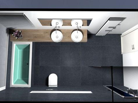 Stijlvol, strak en ruimtelijk. Deze badkamer is heerlijk ruimtelijk ingedeeld. Onder de twee opzetwastafels is een maatwerk houten onderkast gemaakt. Deze onderkast loopt door tot onder het raam achter het bad. In een soortgelijke rechthoekige lijn is achter het toilet een lange nis gecreëerd. Een sierlijk detail in de rustige witte kleur. De badkamer oogt mede ruimtelijk door het maatwerk glas dat is toegepast bij de inloopdouche. In de inloopdouche is een Sunshower DeLuxe Health ingebouwd…