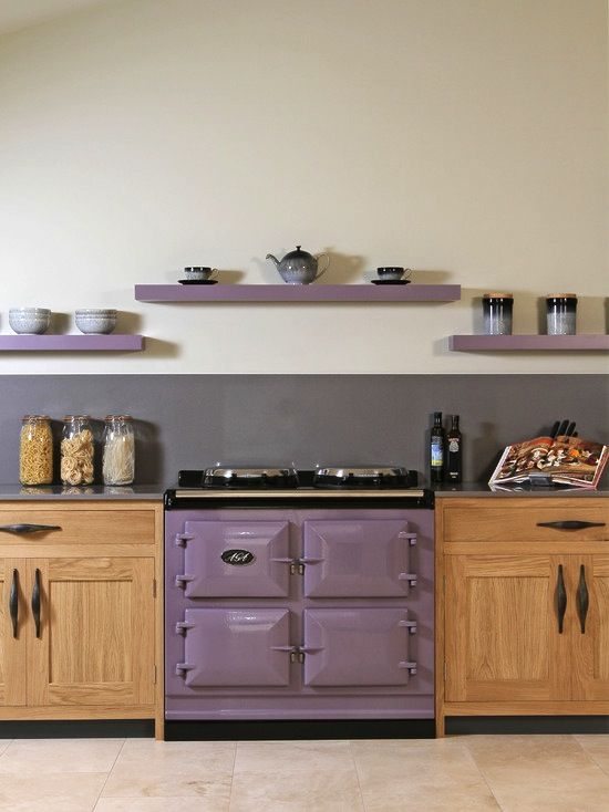 This purple on the cabinets? With medium grey floors and white walls. 14 Creative Ways to Decorate a Kitchen With Purple