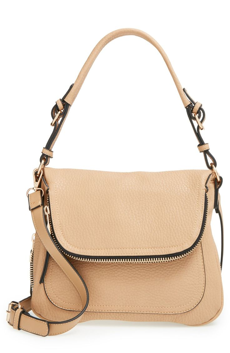 Modern curves define this spacious shoulder bag featuring for Define faux leather