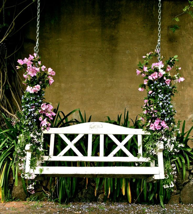 A Wedding Swing is a unique & beautiful addition to your wedding venue when decorated by a florist. Makes for great photographs after the ceremony too / Modern Wedding