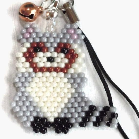 Known to be agile and cunning, flexible and fast...is that you? Well, its actually Rocky the seed bead raccoon charm modeled after the stuffed animal