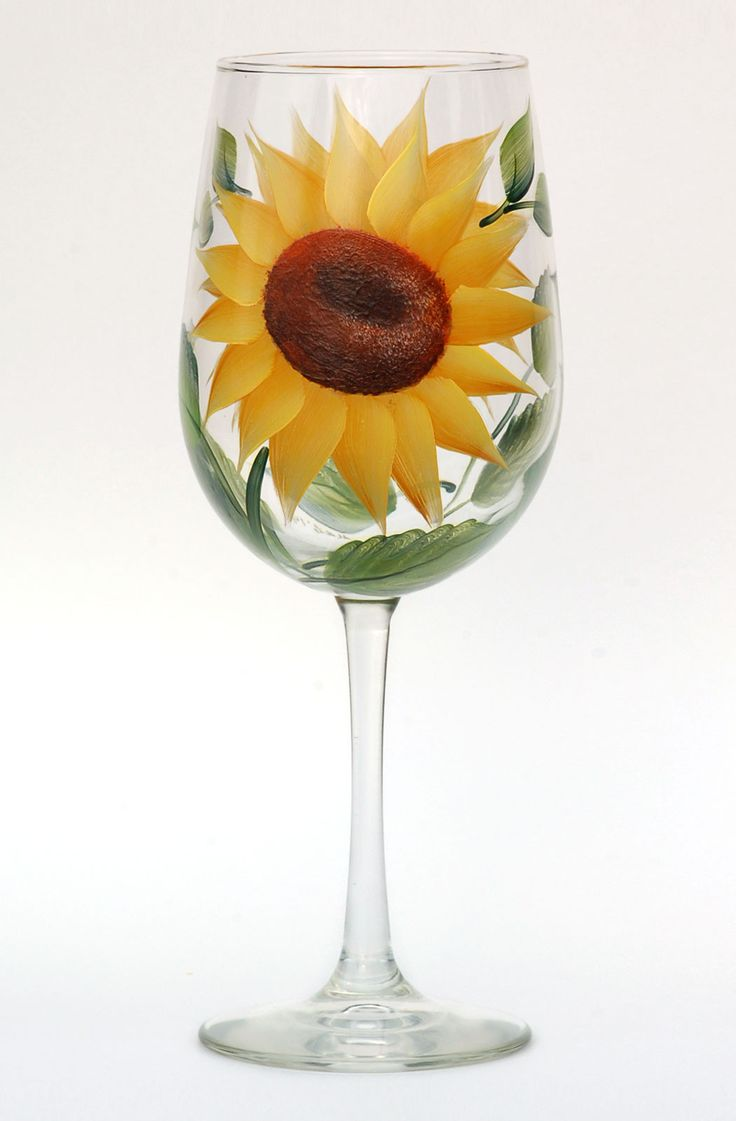 Bright yellow sunflower petals with deep brown centers and deep green leaves hand-painted on 18.5 ounce quality wine glass.