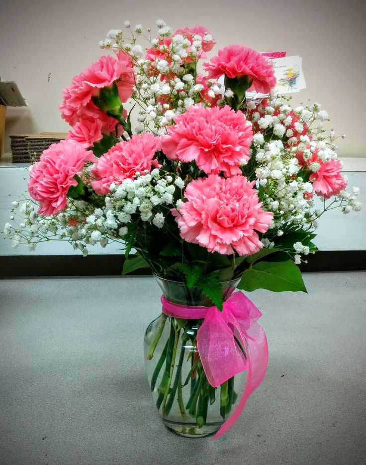 Pink carnations & babies breath.