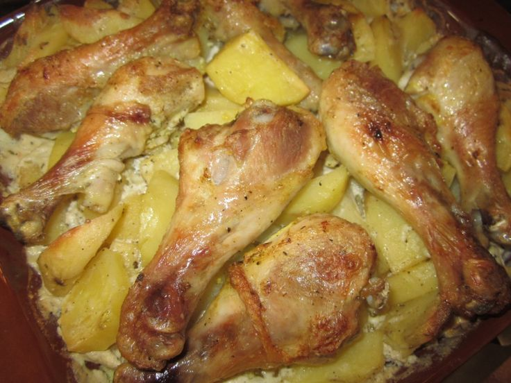 Potatoes with chicken legs in the oven