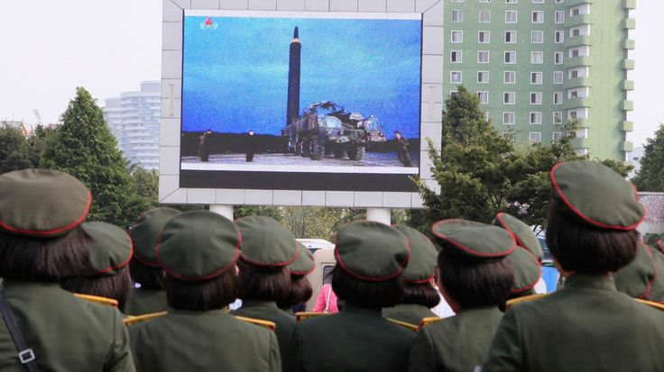 PsBattle: North Koreans watching screen