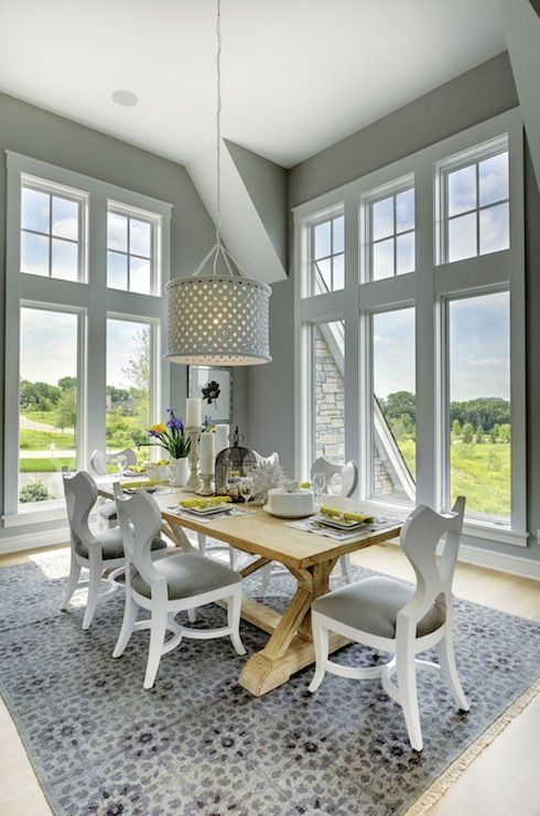 Stunning Dining Room With Floor Length Picture Windows