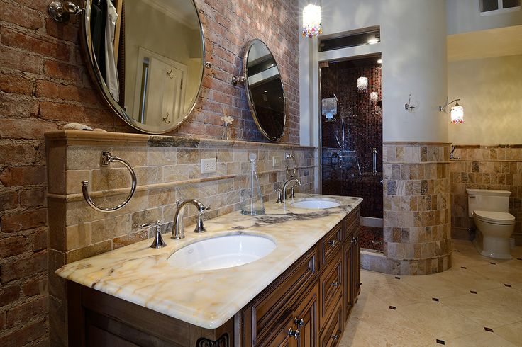 magnificently appointed with onyx tile, custom marble vanity, Swarovski crystal lighting and an oversized walk-in spa shower. #Hoboken