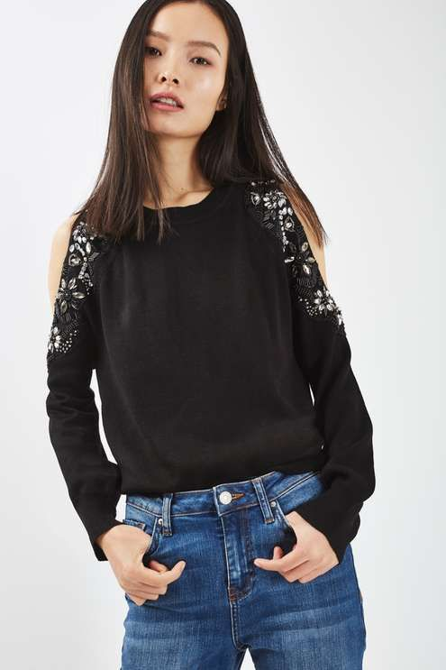 Revamp your knitwear in this pretty knitted jumper with embellished cold shoulder detail for a feminine feel. A day or night piece, we've styled with frayed hem jeans for an updated look. #Topshop