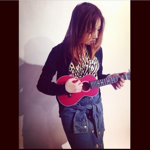 """Minzy IG Update. """"How to play the #Ukulele... Supported by @.byungyoonsong"""""""