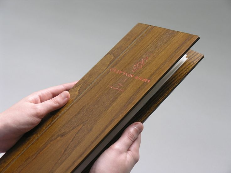 Wood menu with copper foil print finish for hotel, restaurant, bar and brasserie Clifton Arms designed by Wash