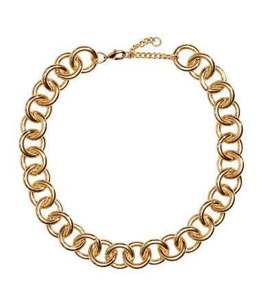 Gold-colored. Short necklace in chunky metal chain. Adjustable length, 15 3/4 - 17 3/4 in.